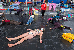 "© Licensed to London News Pictures;02/09/2020; Cardiff, Wales, UK. Extinction Rebellion protest with a symbolic ""drown in"" in Cardiff Bay in front of the Senedd, the Welsh Government building, in support of the upcoming Climate and Ecological Emergency Bill. Today the protest is ""Rising Tide Action!!"" focusing on the impact that the climate crisis is having locally and across Wales because it is impacting weather cycles, flooding, air pollution and our food security. The protest involved arts, theatre, speakers, music, banners and a drown in. The protest is part of a national protest over the next two weeks including London and other cities in the UK against climate change. XR say that despite clear scientific evidence of the deadly climate and ecological emergency, the UK government are refusing to take the urgent action needed to avoid mass extinction, and that politicians need to support the Climate and Ecological Emergency Bill. During the coronavirus covid-19 pandemic, climate change is being forgotten but it is still an emergency that is happening. The protest was socially distanced and participants wore masks. Photo credit: Simon Chapman/LNP."