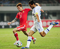 Zhang Linpeng of China, left, challenges Roque Santa Cruz of Paraguay during a friendly football match in Changsha city, central China's Hunan province, 14 October 2014.<br /> <br /> Paraguay's dismal run of form continued as they suffered a 2-1 friendly defeat to China on Tuesday (14 October 2014). The South American nation, who came into the game having won two of their previous 13 fixtures, fell short in their bid to pull off a late comeback at Changsha's Helong Stadium. In contrast to their opponents, China have now lost just two of their last 16 matches as they continue to build towards next year's AFC Asian Cup in Australia.