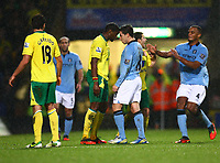 Football - 2012 / 2013 Premier League - Norwich vs. Manchester City<br /> <br /> Manchester City's Samir Nasri and Norwich City's Sebastien Bassong clash against each other at Carrow Road, Norwich