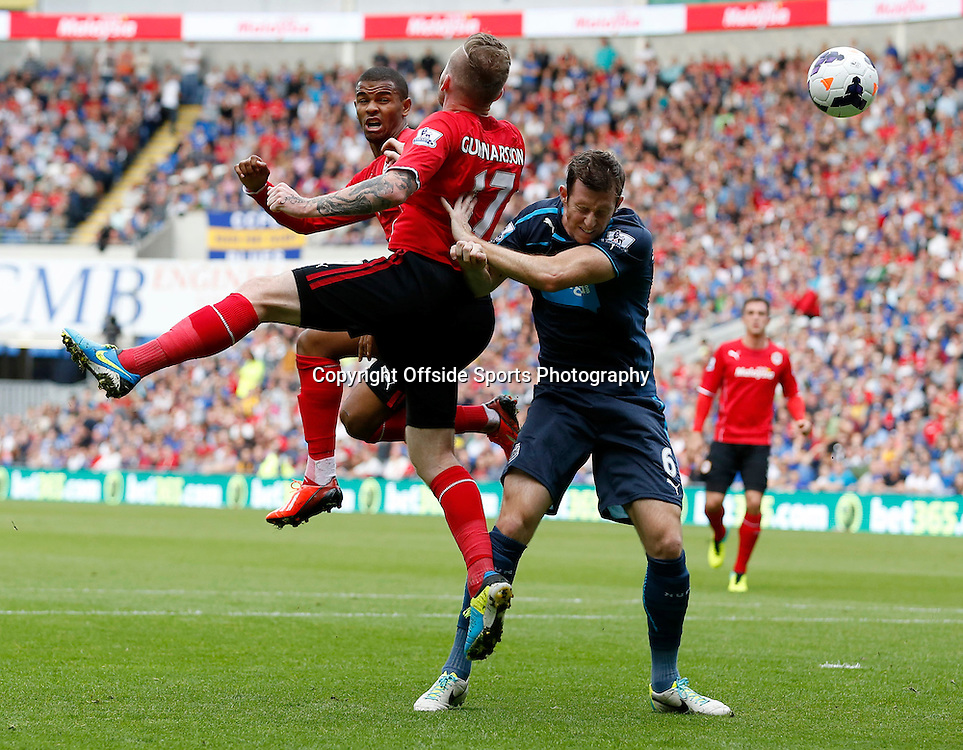 5th October 2013- Barclays Premier League - Cardiff City Vs Newcastle United - Fraizer Campbell and Aron Gunnarsson of Cardiff City leap for a corner as Michael Williamson of Newcastle United challenges - Photo: Paul Roberts / Offside.