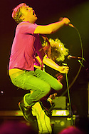 Ricky Wilson of the Kaiser Chiefs leaps into the air during his bands set at the Park West in Chicago, IL.