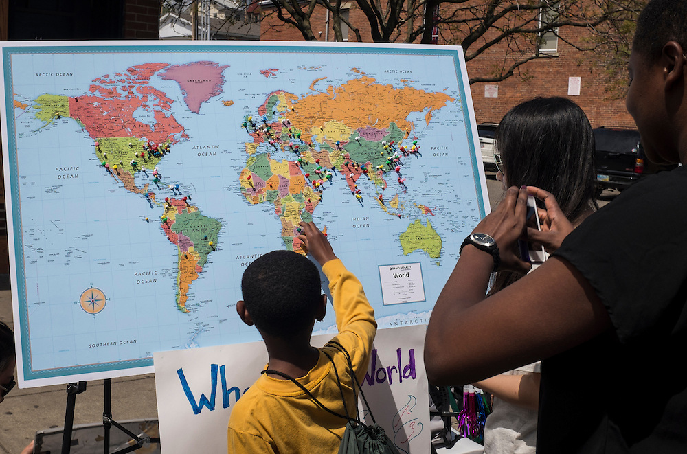 "A young visitor ads to the ""Where in the World are You From?"" pin board during the International Street Fair on Saturday, April 18, 2015."