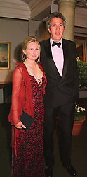 MR & MRS HENRY WYNDHAM he is chairman of Sotheby's Europe, at a dinner in London on 19th May 1998.MHS 5