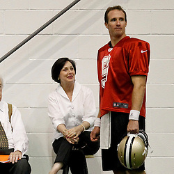 July 26, 2012; Metairie, LA, USA; New Orleans Saints owner Tom Benson along with his wife Gayle Benson talk with quarterback Drew Brees (9) during the first day of of training camp at the team's practice facility. Mandatory Credit: Derick E. Hingle-US PRESSWIRE