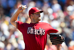 May 30, 2010; San Francisco, CA, USA;  Arizona Diamondbacks relief pitcher Aaron Heilman (22) pitches against the San Francisco Giants during the seventh inning at AT&T Park.  San Francisco defeated Arizona 6-5 in 10 innings.