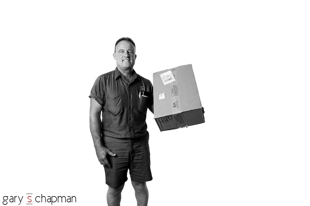 Gary's favorite way to shop for personal items or professional gear is online. Charlie, our UPS carrier, has come to our house countless times over the years, but it's the first time Gary has been able to take his portrait.