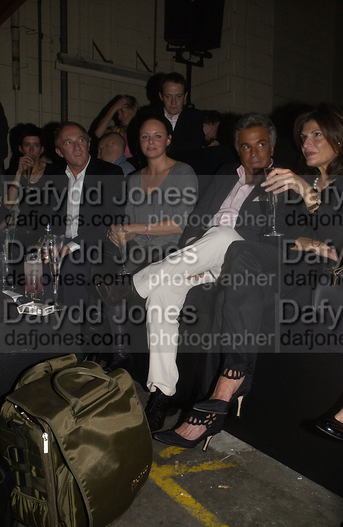 Stella McCartney and Giancarlo Giacometti -. Established and Sons UK Launch during Design Week. The Bus Depot, Hertford Road. Hoxton. 22 September 2005.  ONE TIME USE ONLY - DO NOT ARCHIVE © Copyright Photograph by Dafydd Jones 66 Stockwell Park Rd. London SW9 0DA Tel 020 7733 0108 www.dafjones.com