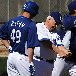 Former Los Angeles Dodgers manager Tommy Lasorda works with Trent Oeltjen (49) before a spring training game at Camelback Ranch Stadium as the Dodgers beat the White Sox's 6-5 on Monday, February 28, 2011, in Glendale,Arizona. (SGVN/Staff Photo by Keith Birmingham/SPORTS)
