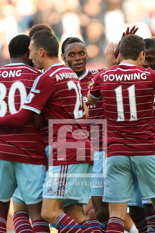 Diafra Sakho (centre) celebrates amongst team mates after scoring the opening goal of the Barclays Premier League match against Queens Park Rangers at the Boleyn Ground, London<br /> Picture by Richard Calver/Focus Images Ltd +447792 981244<br /> 05/10/2014
