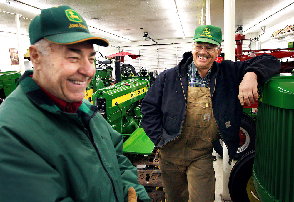 Arrington chats with friend and neighbor Phil Eastburn.  Eastburn, who was a childhood friend of James Dean in Fairmount, IN, has a penchant for collecting and upkeeping vintage farm equipment.