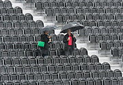 Fans standing in the temporary stand with umbrellas up as it rains ahead of play on day 3 during the International Test Match 2019, fourth test, day three match between England and Australia at Old Trafford, Manchester, England on 6 September 2019.