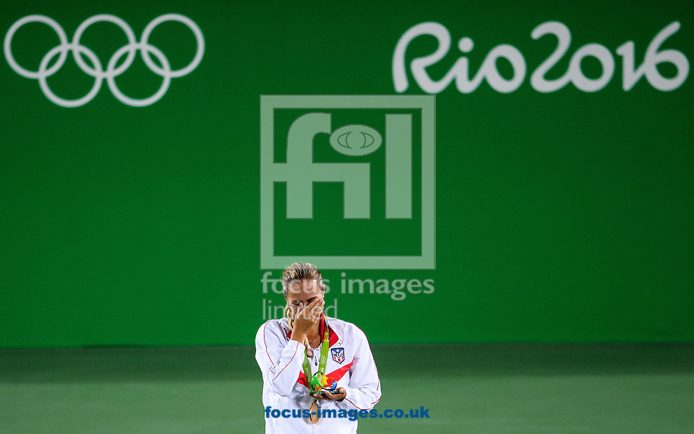 Monica Puig of Puerto Rico wins the Gold Medal in the Women's Tennis Singles on day eight of the XXXI 2016 Olympic Summer Games in Rio de Janeiro, Brazil.<br /> Picture by EXPA Pictures/Focus Images Ltd 07814482222<br /> 13/08/2016<br /> *** UK &amp; IRELAND ONLY ***<br /> <br /> EXPA-EIB-160814-0022.jpg