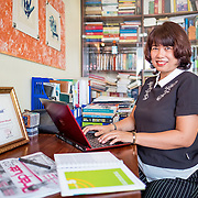 "INDIVIDUAL(S) PHOTOGRAPHED: Bùi Thị Xuân Hoa. LOCATION: Home of Bùi Thị Xuân Hoa in Hanoi, Vietnam. STORY: As an experienced journalist and editor at the newspaper Vietnam Law , Hoa makes a point of actively censoring any stereotypical gender connotations in articles before they go to print. She also educates her fellow journalists on their potential roles in perpetrating gender stereotypes. To guide her, she uses the Gender Sensitivity Guidelines developed by Oxfam and the Center for Studies and Applied Sciences in Gender, Family, Women and Adolescents as part of an initiative to challenge Vietnamese gender stereotypes. As part of her participation in the project, Hoa also attended several training sessions and field trips focused on gender-sensitive communication. This five-year project worked with leading media outlets, such as Voice of Vietnam Radio and Tin Tuc Online (TTOL), universities and media regulatory bodies to encourage balanced reporting styles, the promotion of equal rights for both genders and coverage of debates on gender-related topics such as domestic violence. The project also contributed to the 2012 Advertisement Law (which prohibits the use of gender stereotypes in advertising) and influenced the framing of the 2011 National Strategy on Gender Equality. Hoa is one of over 50 journalists targeted by the project. What they've achieved is encouraging. One of TTOL's articles on gender equality, for instance, reached 65,000 readers. ""I still keep the guidelines on my desk for editing articles,"" Hoa affirms. ""People's perceptions are starting to change, and it's so important to show that women can have the same aspirations as men, rather than simply aiming to be 'the perfect wife'""."