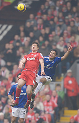 Liverpool, England - Saturday, February 3, 2007: Liverpool's Xabi Alonso and Everton's Tim Cahill during the Merseyside Derby Premiership match at Anfield. (Pic by David Rawcliffe/Propaganda)