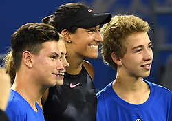 WUHAN, Sept. 27, 2017 Caroline Garcia of France pose for photos with ball boys and girls after the singles third round match against Dominika Cibulkova of Slovakia at 2017 WTA Wuhan Open in Wuhan, capital of central China's Hubei Province, on Sept. 27, 2017. Caroline Garcia won 2-0.  wdz) (Credit Image: © Cheng Min/Xinhua via ZUMA Wire)