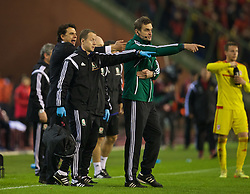 BRUSSELS, BELGIUM - Sunday, November 16, 2014: Fourth official Antonin Kordula refuses permission for Wales' Medical Officer Doctor Jon Houghton to enter the pitch despite a player having a head injury and the game already being suspended during the UEFA Euro 2016 Qualifying Group B game against Belgium at the King Baudouin [Heysel] Stadium. (Pic by David Rawcliffe/Propaganda)