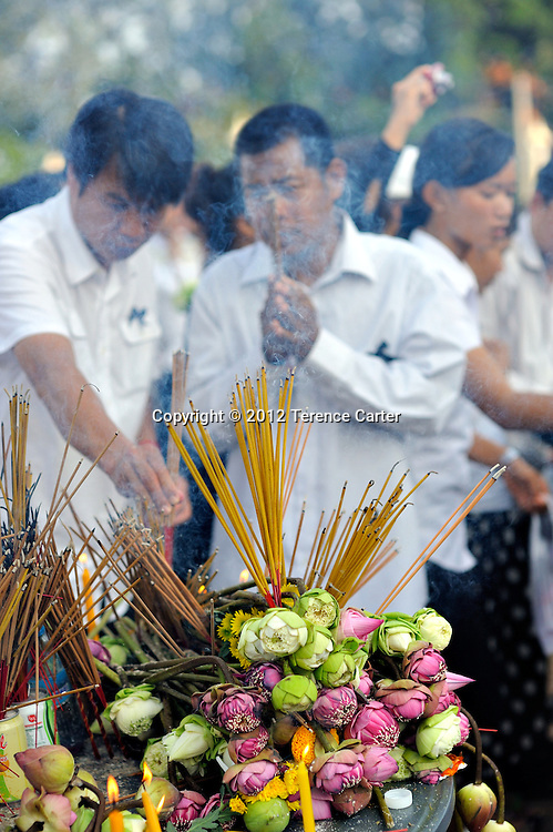 Mourners pay respects as they await King Father Norodom Sihanouk's body to be returned to the Royal Palace, Phnom Penh, starting a week of mourning in Cambodia.