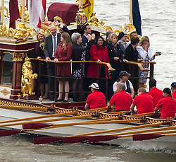 © Licensed to London News Pictures. 09/09/2015. London, UK. People on board British royal rowbarge Gloriana leading the flotilla as it passes underneath the raised bridge at Tower Bridge. . A Royal River Salute takes place at Tower Bridge in London to mark the Queen becoming the longest reigning monarch in British history. The Queen will have reigned for 63 years and seven months , passing the record set by her great-great-grandmother Queen Victoria. Photo credit: Ben Cawthra/LNP
