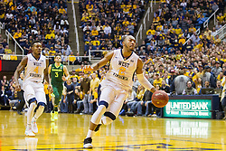 Jan 10, 2017; Morgantown, WV, USA; West Virginia Mountaineers guard Jevon Carter (2) dribbles the ball during a fast break during the second half against the Baylor Bears at WVU Coliseum. Mandatory Credit: Ben Queen-USA TODAY Sports