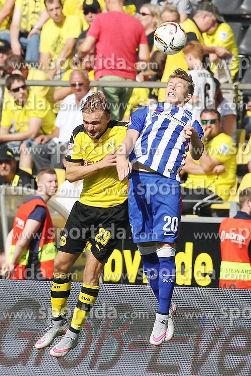 30.08.2015, Signal Iduna Park, Dortmund, GER, 1. FBL, Borussia Dortmund vs Hertha BSC, 3. Runde, im Bild Mitchell Weiser (Hertha BSC Berlin #20) im Kopfballduell gegen Marcel Schmelzer (Borussia Dortmund #29) // during the German Bundesliga 3rd round match between Borussia Dortmund and Hertha BSC at the Signal Iduna Park in Dortmund, Germany on 2015/08/30. EXPA Pictures &copy; 2015, PhotoCredit: EXPA/ Eibner-Pressefoto/ Schueler<br /> <br /> *****ATTENTION - OUT of GER*****