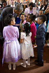 President Barack Obama talks with children during an Easter service at the Alfred Street Baptist Church in Alexandria, Va., Sunday, April 5, 2015. (Official White House Photo by Pete Souza)<br /> <br /> This official White House photograph is being made available only for publication by news organizations and/or for personal use printing by the subject(s) of the photograph. The photograph may not be manipulated in any way and may not be used in commercial or political materials, advertisements, emails, products, promotions that in any way suggests approval or endorsement of the President, the First Family, or the White House.