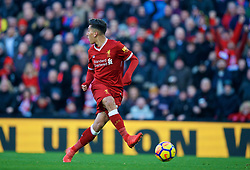 LIVERPOOL, ENGLAND - Saturday, February 24, 2018: Liverpool's Roberto Firmino looks away as he scores the third goal during the FA Premier League match between Liverpool FC and West Ham United FC at Anfield. (Pic by David Rawcliffe/Propaganda)