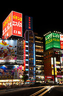 Neon signs on modern highrise buildings in Kabukicho, a centre of nightlife in Tokyo, Honshu, Japan
