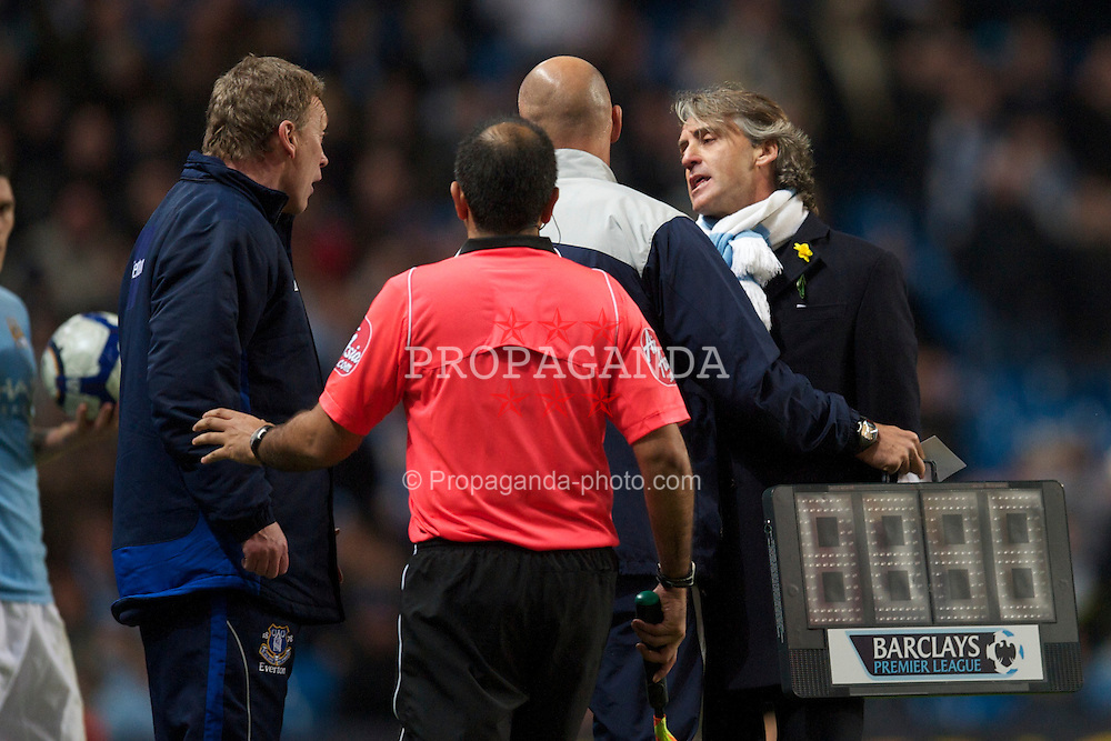 MANCHESTER, ENGLAND - Wednesday, March 24, 2010: Manchester City's manager Roberto Mancini challenges Everton's manager David Moyes as the fourth official Howard Webb steps in to separate them during the Premiership match at the City of Manchester Stadium. (Photo by David Rawcliffe/Propaganda)