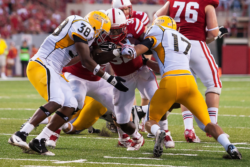 September 7, 2013: Imani Cross #32 of the Nebraska Cornhuskers ends up just shy of a touchdown in the fourth quarter against the Southern Miss Golden Eagles at Memorial Stadium in Lincoln, Nebraska. Next play Cross scores.