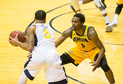 Dec 5, 2015; Morgantown, WV, USA; Kennesaw State Owls guard Kendrick Ray (0) guards West Virginia Mountaineers guard Jaysean Paige (5) during the second half at WVU Coliseum. Mandatory Credit: Ben Queen-USA TODAY Sports