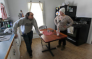 Bennington, VT -  Thursday, Jan. 30, 2014:   Standing across from each other, recovering addict Alfred Hickey, left, talks with fellow renter Cassie Morse, right, in the kitchen.<br />   <br /> Gov. Peter Shumlin devoted his entire state of the state address in January to what he called a &quot;full-blown heroin crisis&quot; in Vermont, where twice as many people died of heroin overdoses in 2012 as in the year before. Mr. Shumlin's address focused new attention on the problem, which has hit every corner of the state.  <br /> <br /> CREDIT: Cheryl Senter for The New York Times