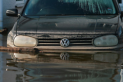 © London News Pictures. 24/02/2014. Moorland, UK. The levels of flood water clearly seen on the front of a car still surrounded by flood water in Moorland on the Somerset Levels, which continues to suffer from sever flooding. Photo credit: Jason Bryant/LNP