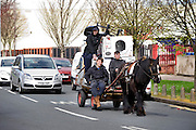 Rag and bone men in Hull, East Yorkshire, with a horse and cart and a full load of scrap metal