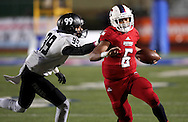 Bishop Dunne's Alec Ralph gets past Bishop Lynch's Gabriel Murphy during the TAPPS Division I state championship game on Saturday, Dec. 3, 2016 at Panther Stadium in Hewitt, Texas. Bishop Lynch High School won 21-17. (Photo by Kevin Bartram)