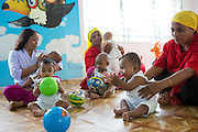 Young children playing in the child care centre at an Epyllion Group garment factory in Dhaka, Bangladesh.