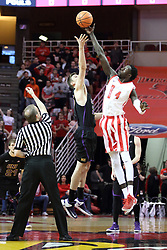 """17 February 2018:  Randy Heimerman tosses the tip off for Bennett Koch and Daouda """"David"""" Ndiaye during a College mens basketball game between the University of Northern Iowa Panthers and Illinois State Redbirds in Redbird Arena, Normal IL"""