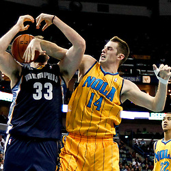 Dec 7, 2012; New Orleans, LA, USA; New Orleans Hornets power forward Jason Smith (14) fouls Memphis Grizzlies center Marc Gasol (33) during the second half of a game at the New Orleans Arena.  The Grizzlies defeated the Hornets 96-89. Mandatory Credit: Derick E. Hingle-USA TODAY Sports