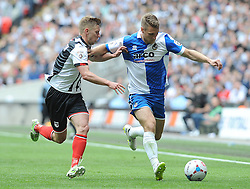 Bristol Rovers' Lee Brown is challenged by Grimsby's Jack Mackreth - Photo mandatory by-line: Neil Brookman/JMP - Mobile: 07966 386802 - 17/05/2015 - SPORT - football - London - Wembley Stadium - Bristol Rovers v Grimsby Town - Vanarama Conference Football