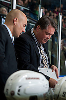 KELOWNA, CANADA - OCTOBER 23: Roman Vopat, assistant coach and Mark Holick, head coach of the Prince George Cougars go over a play on the bench against the Kelowna Rockets on October 23, 2015 at Prospera Place in Kelowna, British Columbia, Canada.  (Photo by Marissa Baecker/Shoot the Breeze)  *** Local Caption *** Roman Vopat; Mark Holick;