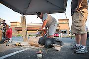 Ray Schulz visits Black Bear Diner in Milpitas, Calif. to demonstrate the chainsaw carving of the Black Bear wooden sculptures on July 11, 2012.  Schulz has been sculpting bears and other figures with a chainsaw for over 15 years.  Photo by Stan Olszewski/SOSKIphoto.