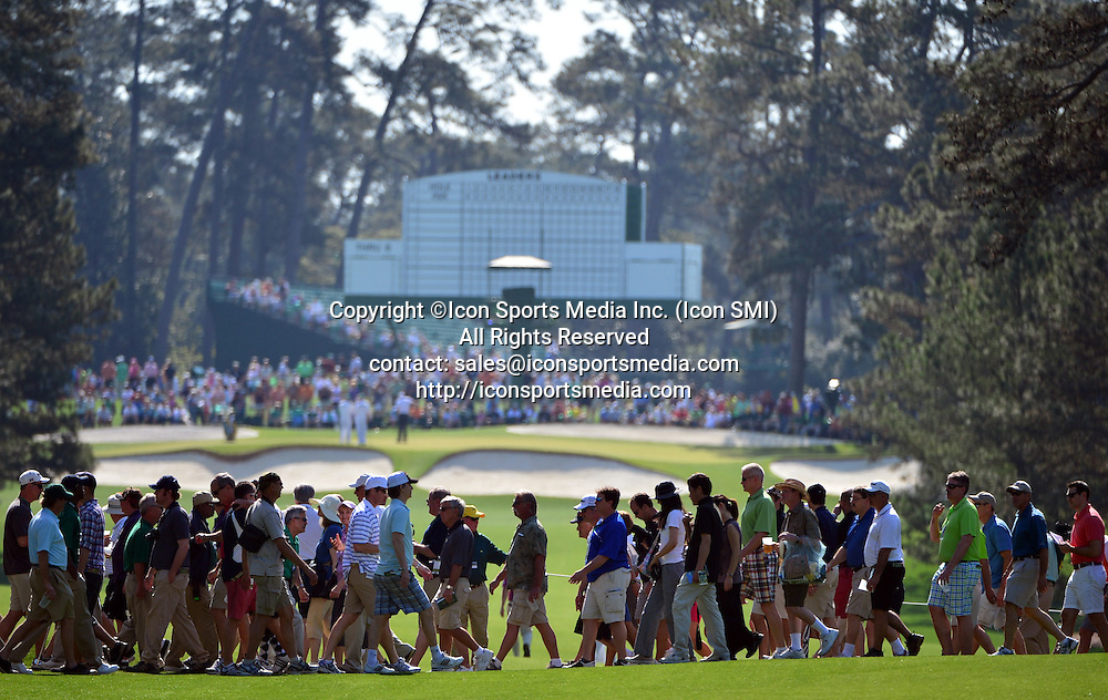 April 9, 2013 - Augusta, Georgia, U.S. - Patrons cross the 7 fairway during the second practice round of the 2013 Masters Tournament at Augusta National Golf Club on April 9, 2013, in Augusta, Ga.