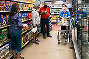 "03 AUGUST 2020 - JEWELL, IOWA:  SUSAN LUND and her husband, EUDENE LUND, shop in the Jewell Market Monday. Susan said the new market meant everything for them. Before it reopened they had to drive to Ames, IA, about 20 miles away, for groceries. With the store in town, it is easier to pick up something when they need it. The only grocery store in Jewell, a small community in central Iowa, closed in 2019. It served four communities within a 20 mile radius of Jewell. Some of the town's residents created a cooperative to reopen the store. They sold shares to the co-op and  held fundraisers through the spring. Organizers raised about $225,000 and bought the store, which had its ""soft opening"" July 8. The store celebrated its official reopening Monday August 3. Before the reopening, Jewell had been a ""food desert"" for seven months. The USDA defines rural food deserts as having at least 500 people in a census tract living 10 miles from a large grocery store or supermarket. There is a convenience store in Jewell, but it sells mostly heavily processed, unhealthy snack foods that are high in fat, sugar, and salt.          PHOTO BY JACK KURTZ"