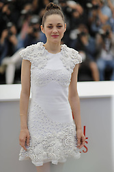 59694546.French actress Marion Cotillard poses during a photocall for the film The Immigrant at the 66th edition of the Cannes Film Festival in Cannes, on May 24, 2013..UK ONLY