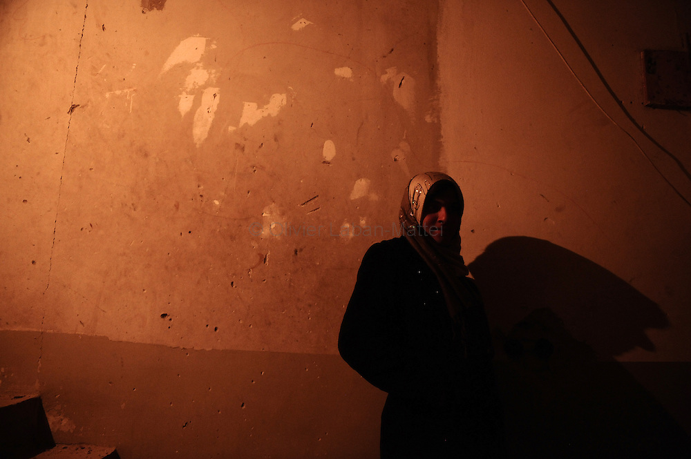 A Palestinian woman stands in the only room in her house which was not destroyed during Israel's 22-day offensive in Jabalia's Ezbet Abed Rabbo district in the northern Gaza Strip late on January 30, 2009. A rocket fired by Palestinian militants from the Gaza Strip exploded in southern Israel on January 31, but there were no casualties or damage reported, the Israeli army said. It is the third rocket attack since ceasefires on January 18 brought an end to Israel's three-week onslaught against Gaza which left more than 1,330 Palestinians dead.
