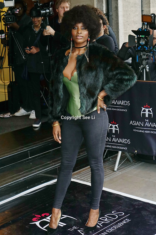 London,England,UK : 8th April 2016 : A stunning African pop star attend the The Asian Awards 2016 at Grosvenor House Hotel, Park Lane, London. Photo by See Li