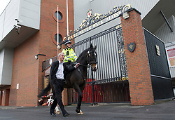 LIVERPOOL, ENGLAND - Monday, April 4, 2011: Liverpool's legendary number nine Ian Rush pictured outside the Shankly Gates at Anfield with Jaguar the Merseyside Police Horse Number Nine ridden by Sergeant Sarah Hamilton. Jaguar will be leading the winning horse to the winner's circle on Saturday at the John Smith's Aintree Grand National. (Photo by David Rawcliffe/Propaganda)