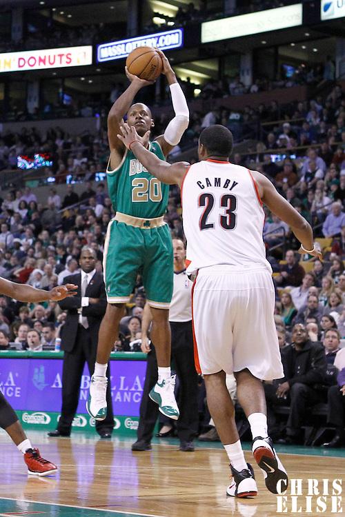 09 March 2012: Boston Celtics shooting guard Ray Allen (20) takes a jumpshot over  Portland Trailblazers center Marcus Camby (23) during the Boston Celtics 104-86 victory over the Portland Trail Blazers at the TD Banknorth Garden, Boston, Massachusetts, USA.