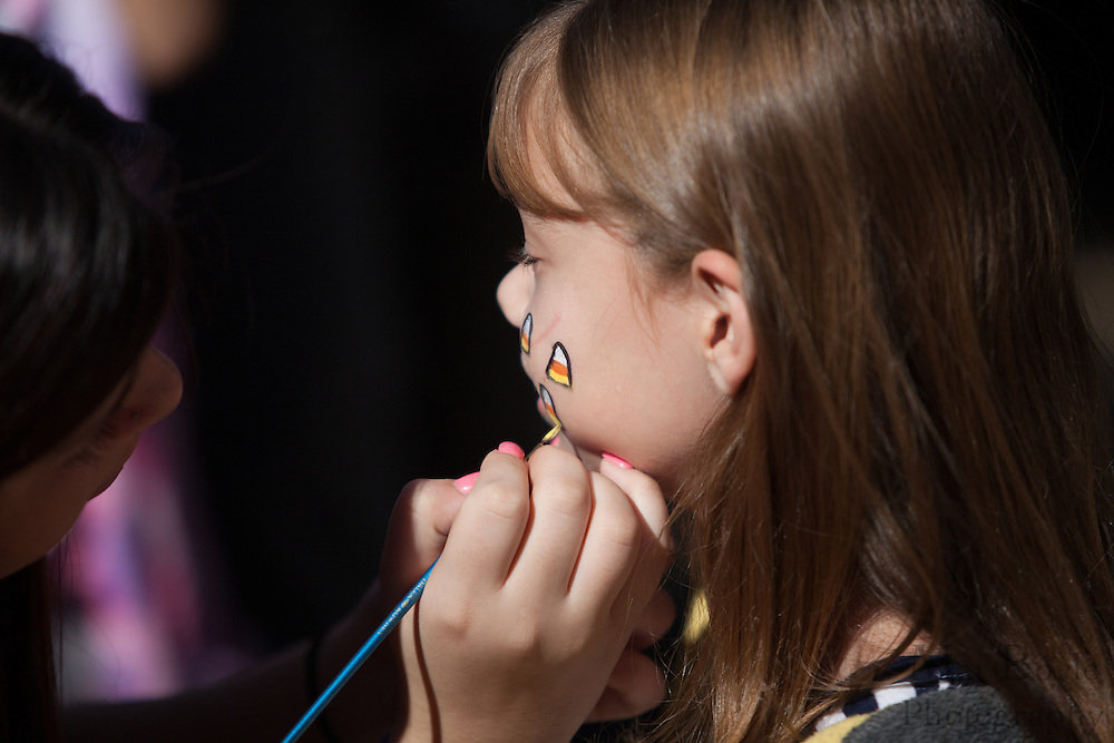 Sarah Durso, 8 of Somerdale, gets her face painted during the Blackwood Pumpkin Festival on Sunday October 14, 2012. (photo / Mat Boyle)