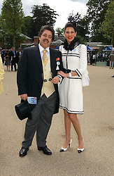 MR & MRS WALID JUFFALI she was Christina Estrada at the first day of the Royal Ascot racing festival 2006 at Ascot Racecourse, Berkshire on 20th June 2006.<br />