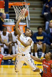 West Virginia Mountaineers guard Juwan Staten (3) shoots a layup against the Texas Tech Red Raiders during the second half at the WVU Coliseum.